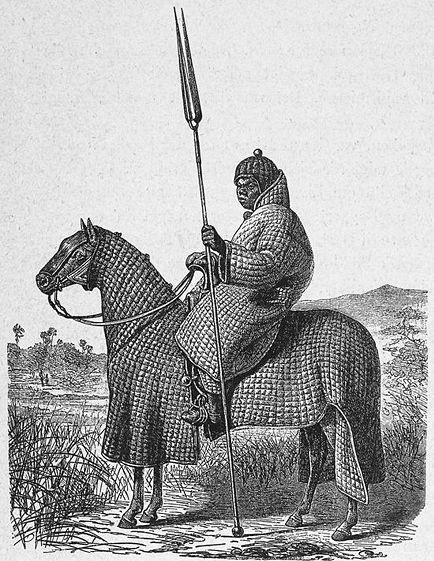 """""""Jaquetão"""" é uma túnica acolchoada com linho ou lã, o que D&D trata como """"armadura acolchoada"""". A imagem acima traz um cavaleiro africano e seu cavalo inteiramente cobertos neste tipo de proteção: clique na imagem para ir na fonte."""